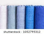 blue tone colored linen fabric... | Shutterstock . vector #1052795312