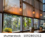 roll blinds to protect sunlight ... | Shutterstock . vector #1052801312