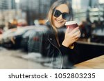 young girl sit in coffee place... | Shutterstock . vector #1052803235