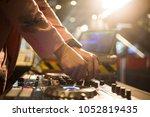 dj mixes the track in nightclub ... | Shutterstock . vector #1052819435