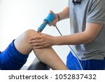 physical therapy of the knee... | Shutterstock . vector #1052837432
