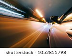 car on the road with motion... | Shutterstock . vector #1052855798