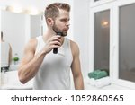 handsome young bearded man... | Shutterstock . vector #1052860565