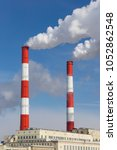 two smoking chimneys of a large ... | Shutterstock . vector #1052862548