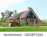 traditional dutch thatch roof... | Shutterstock . vector #1052871362