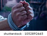 close up of man hands wrapped... | Shutterstock . vector #1052892665