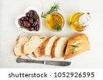 fresh ciabatta with olive oil... | Shutterstock . vector #1052926595