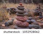 stone cairn rock standing tower ... | Shutterstock . vector #1052928062