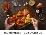 hands brush baked wings with... | Shutterstock . vector #1052938508