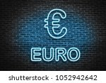 blue neon euro sign  in old... | Shutterstock . vector #1052942642