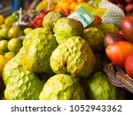 fresh fruits at market with... | Shutterstock . vector #1052943362