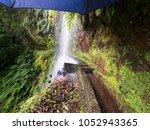 approaching a waterfall during... | Shutterstock . vector #1052943365