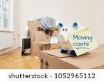 moving expenses  a piggy bank...   Shutterstock . vector #1052965112