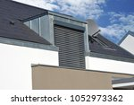 roof with metal plated dormer... | Shutterstock . vector #1052973362