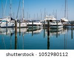 white yachts in the port are... | Shutterstock . vector #1052980112