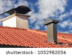 copper fume hood and chimney on ... | Shutterstock . vector #1052982056