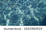 drawings in blue water | Shutterstock . vector #1052983925
