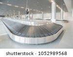 defocused suitcase conveyor belt | Shutterstock . vector #1052989568