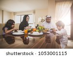 arabic happy family lifestyle... | Shutterstock . vector #1053001115