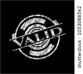 valid chalk emblem written on a ... | Shutterstock .eps vector #1053088562