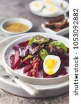 salad from boiled beet  young... | Shutterstock . vector #1053092882