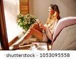 relaxed caucasian girl is... | Shutterstock . vector #1053095558