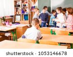 lonely sad boy at the classroom | Shutterstock . vector #1053146678
