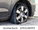 destroyed blown out tire with... | Shutterstock . vector #1053148595