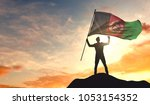 afghanistan flag being waved by ... | Shutterstock . vector #1053154352