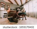 young father and little... | Shutterstock . vector #1053170432