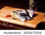 herring fillet  on a cutting... | Shutterstock . vector #1053175256