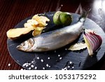 herring entirely with ginger... | Shutterstock . vector #1053175292