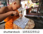 the monks in the temple   wat... | Shutterstock . vector #1053225512