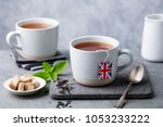 tea in mugs with british flag... | Shutterstock . vector #1053233222