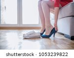 woman changing shoes in office... | Shutterstock . vector #1053239822
