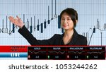 Small photo of Asian female anchorwoman presenting financial news from TV studio, with pip chart background