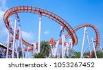 roller coaster with blue sky | Shutterstock . vector #1053267452
