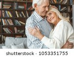 senior couple together at home... | Shutterstock . vector #1053351755