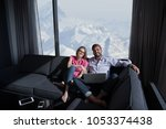 young couple relaxing at  home... | Shutterstock . vector #1053374438