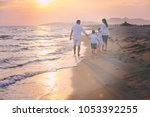 happy young family have fun on... | Shutterstock . vector #1053392255