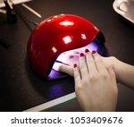 professional manicure in salon. ... | Shutterstock . vector #1053409676