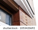 brick house windows with... | Shutterstock . vector #1053420692