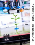 young plant growing.3d printer... | Shutterstock . vector #1053430652