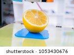 ripe slice of yellow lemon... | Shutterstock . vector #1053430676
