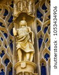 Small photo of Limoges, France - September 28, 2017: statue of hero and openwork ornament, portal of Cathedral