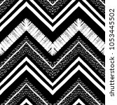 Hand drawn pattern. Zigzag and stripe line. Vector illustration for tribal design. Black and white colors. For textile, wallpaper, wrapping paper. Ethnic theme | Shutterstock vector #1053445502