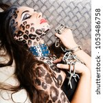 young sexy woman with leopard... | Shutterstock . vector #1053486758