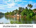 river on the beach in mandrem... | Shutterstock . vector #1053528362