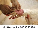 a malay bridegroom  holds his... | Shutterstock . vector #1053553376