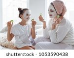 mom with her daughter making... | Shutterstock . vector #1053590438